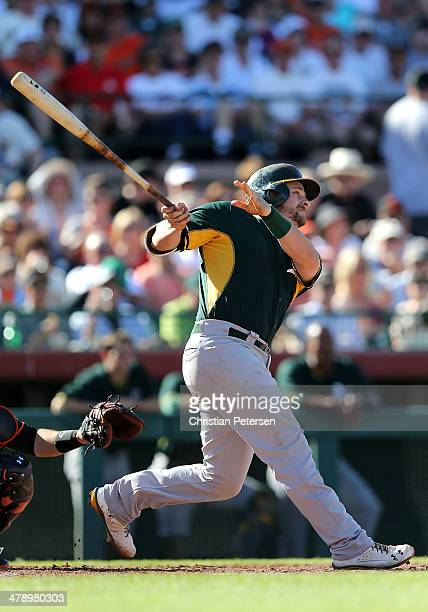 Stephen Vogt of the Oakland Athletics hits a threerun home run against the San Francisco Giants during the third inning of the spring training game...