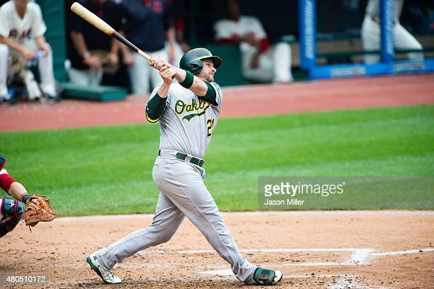 Stephen Vogt of the Oakland Athletics hits a tworun home run during the fourth inning against the Cleveland Indians at Progressive Field on July 12...
