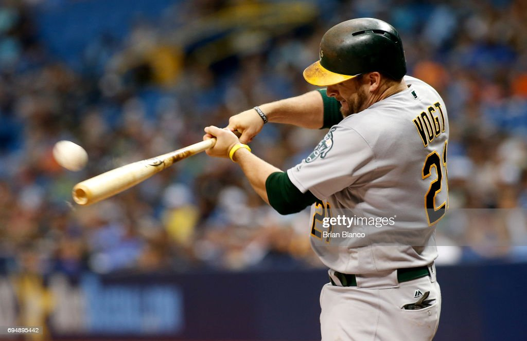 Stephen Vogt #21 of the Oakland Athletics hits an RBI double off of pitcher Chris Archer of the Tampa Bay Rays to score Yonder Alonso during the fourth inning of a game on June 11, 2017 at Tropicana Field in St. Petersburg, Florida.