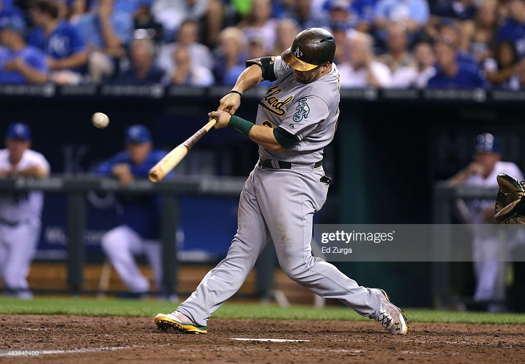 Stephen Vogt #21 of the Oakland Athletics hits an RBI single in the fifth inning against the Kansas City Royals at Kauffman Stadium on August 12, 2014 in Kansas City, Missouri.
