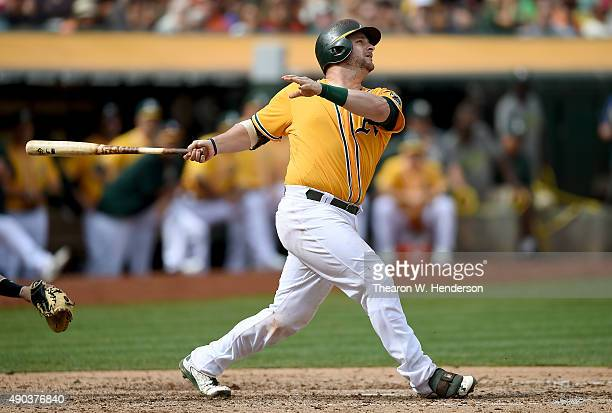 Stephen Vogt of the Oakland Athletics hits an rbi single scoring Max Muncy against the San Francisco Giants in the bottom of the six inning at Oco...