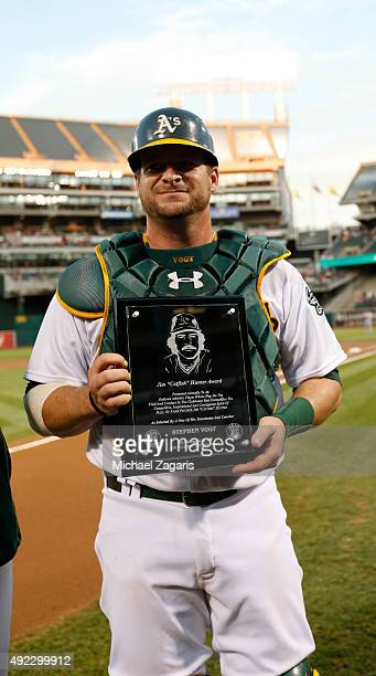 Stephen Vogt of the Oakland Athletics holds his Catfish Hunter Award on the field prior to the game against the San Francisco Giants at Oco Coliseum...
