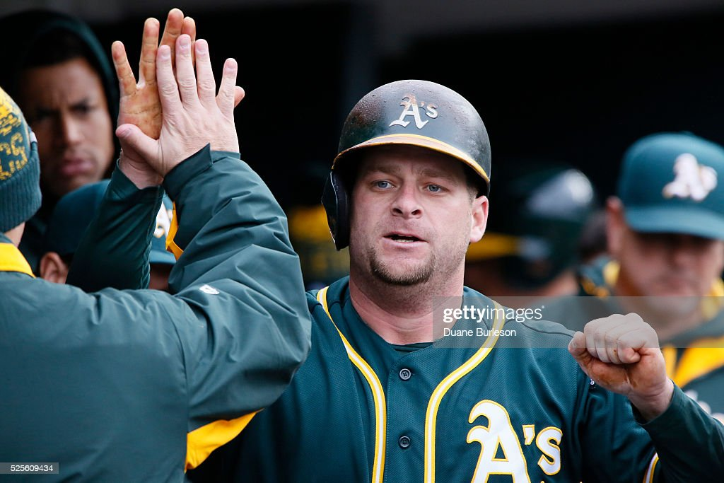 Stephen Vogt #21 of the Oakland Athletics is congratulated after hitting a solo home run against the Detroit Tigers during the fourth inning at Comerica Park on April 28, 2016 in Detroit, Michigan. The Tigers defeated the Athletics 7-3.