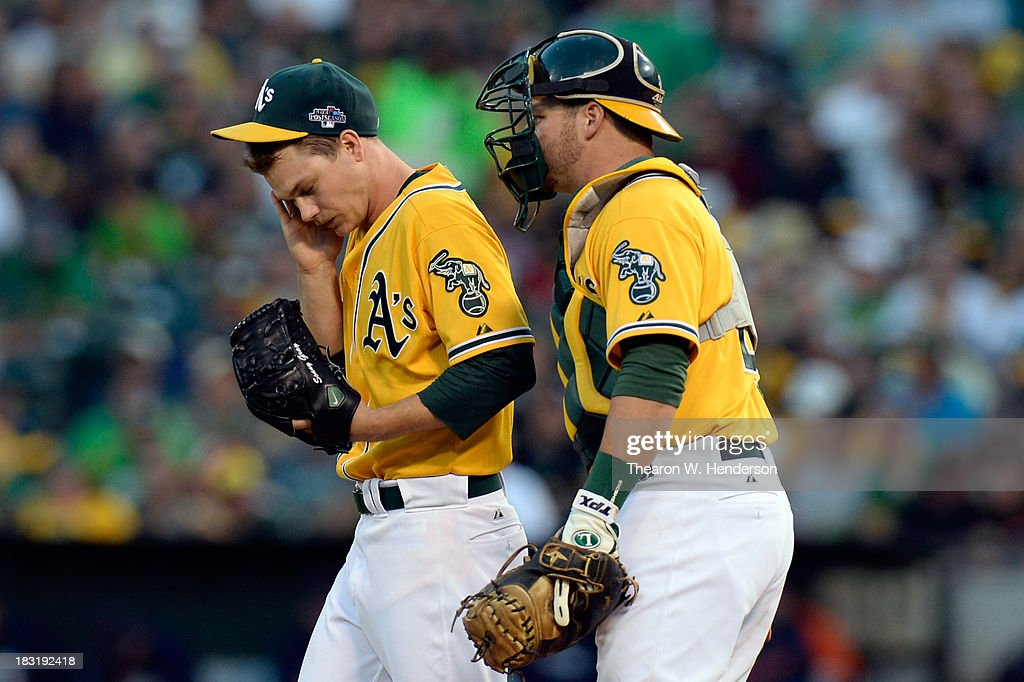Stephen Vogt #21 of the Oakland Athletics talks with teammate Sonny Gray #54 after giving up a walk in the second inning against the Detroit Tigers during Game Two of the American League Division Series at O.co Coliseum on October 5, 2013 in Oakland, California.