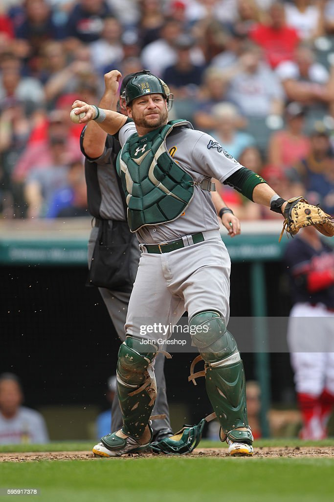 Stephen Vogt of the Oakland Athletics throws the baseball down to first base during the game against the Cleveland Indians at Progressive Field on...