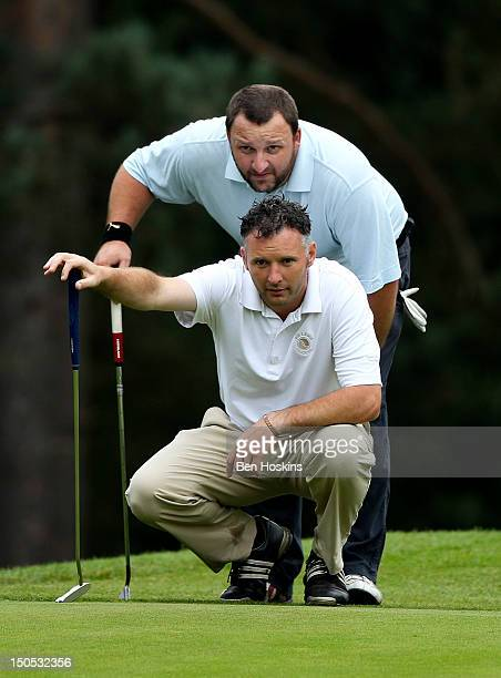 Stephen Ward and Gary Porter of Bishopswood golf Club line up a putt on the 2nd green during the Regional Final of the Virgin Atlantic PGA National...