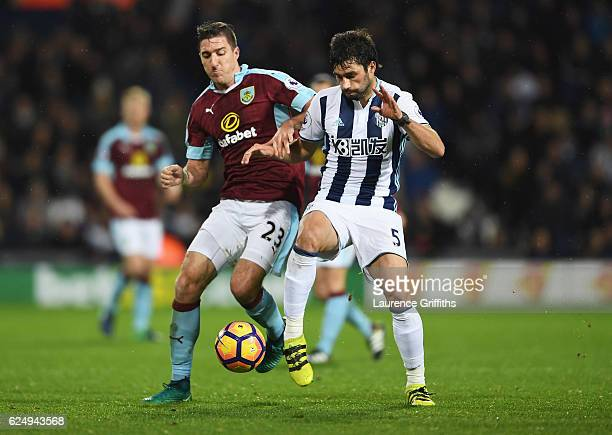 Stephen Ward of Burnley and Claudio Yacob of West Bromwich Albion battle for the bal during the Premier League match between West Bromwich Albion and...