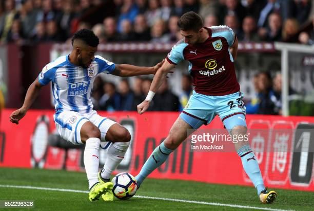 Stephen Ward of Burnley and Elias Kachunga of Huddersfield Town compete for the ball during the Premier League match between Burnley and Huddersfield...