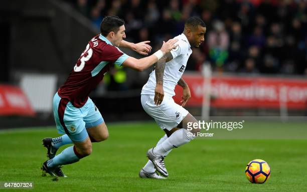 Stephen Ward of Burnley and Luciano Narsingh of Swansea City battle for possession during the Premier League match between Swansea City and Burnley...