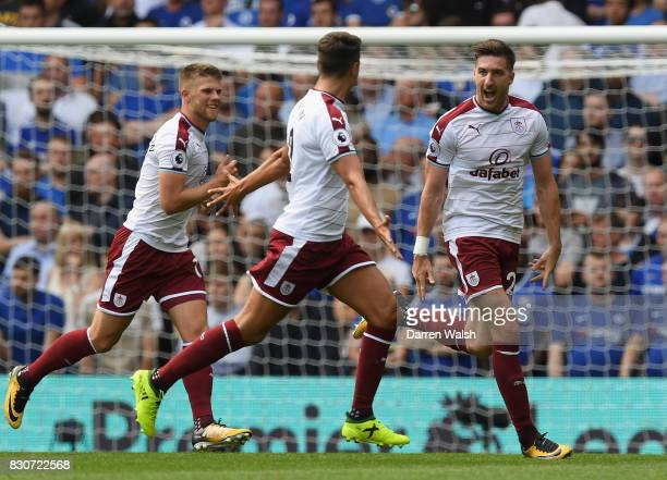 Stephen Ward of Burnley celebrates scoring his sides second goal with his Burnley team mates during the Premier League match between Chelsea and...