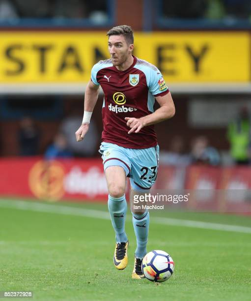 Stephen Ward of Burnley controls the ball during the Premier League match between Burnley and Huddersfield Town at Turf Moor on September 23 2017 in...