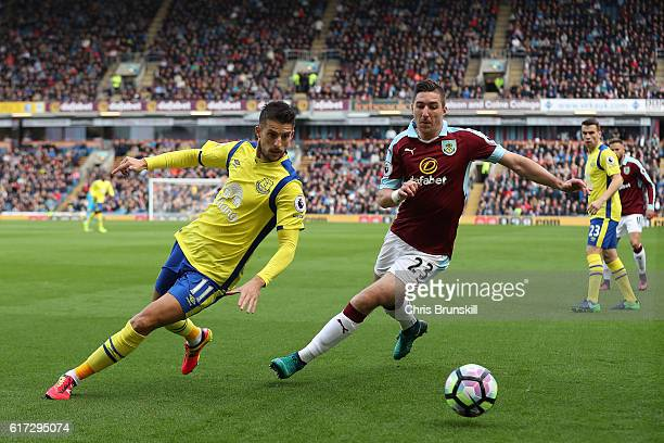 Stephen Ward of Burnley in action with Kevin Mirallas of Everton during the Barclays Premier League match between Burnley and Everton on October 22...