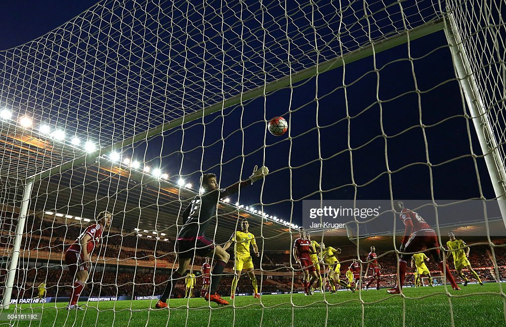 Stephen Ward of Burnley shoots past Tomas Meijias, Goalkeeper of Middlesbrough for the winning goal during the Emirates FA Cup third round match between Middlesbrough and Burnley at Riverside Stadium on January 9, 2016 in Middlesbrough, England.
