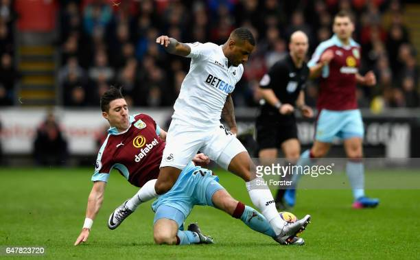 Stephen Ward of Burnley tackles Luciano Narsingh of Swansea City during the Premier League match between Swansea City and Burnley at Liberty Stadium...