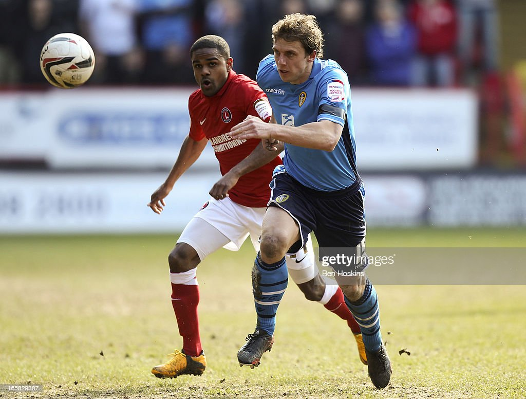 Stephen Warnock of Leeds and Bradley Pritchard of Charlton chase after a loose ball during the npower Championship match between Charlton Athletic and Leeds United at the Valley on April 06, 2013 in London, England.