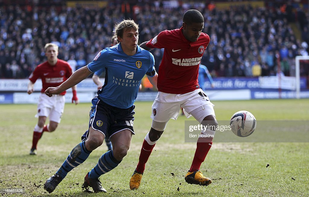 <a gi-track='captionPersonalityLinkClicked' href=/galleries/search?phrase=Stephen+Warnock&family=editorial&specificpeople=224415 ng-click='$event.stopPropagation()'>Stephen Warnock</a> of Leeds battles with Bradley Pritchard of Charlton during the npower Championship match between Charlton Athletic and Leeds United at the Valley on April 06, 2013 in London, England.