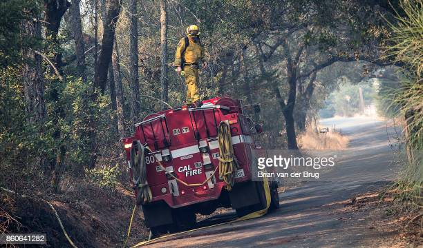 Stephen Warren CalFire engineer checks his foam tank along Petrified Forest Rd while hitting hot spots on October 11 2017 in Calistoga California