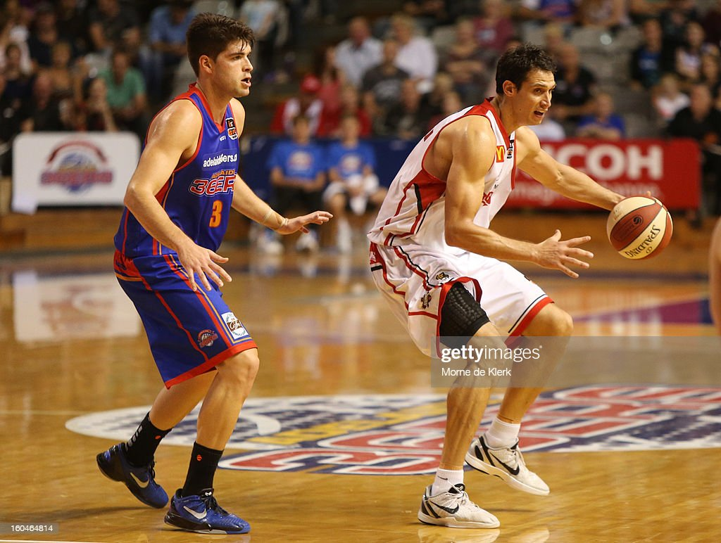 Stephen Weigh (L) of Adelaide competes with Oscar Forman (R) of Wollongong during the round 17 NBL match between the Adelaide 36ers and the Wollongong Hawks at Adelaide Arena on February 1, 2013 in Adelaide, Australia.