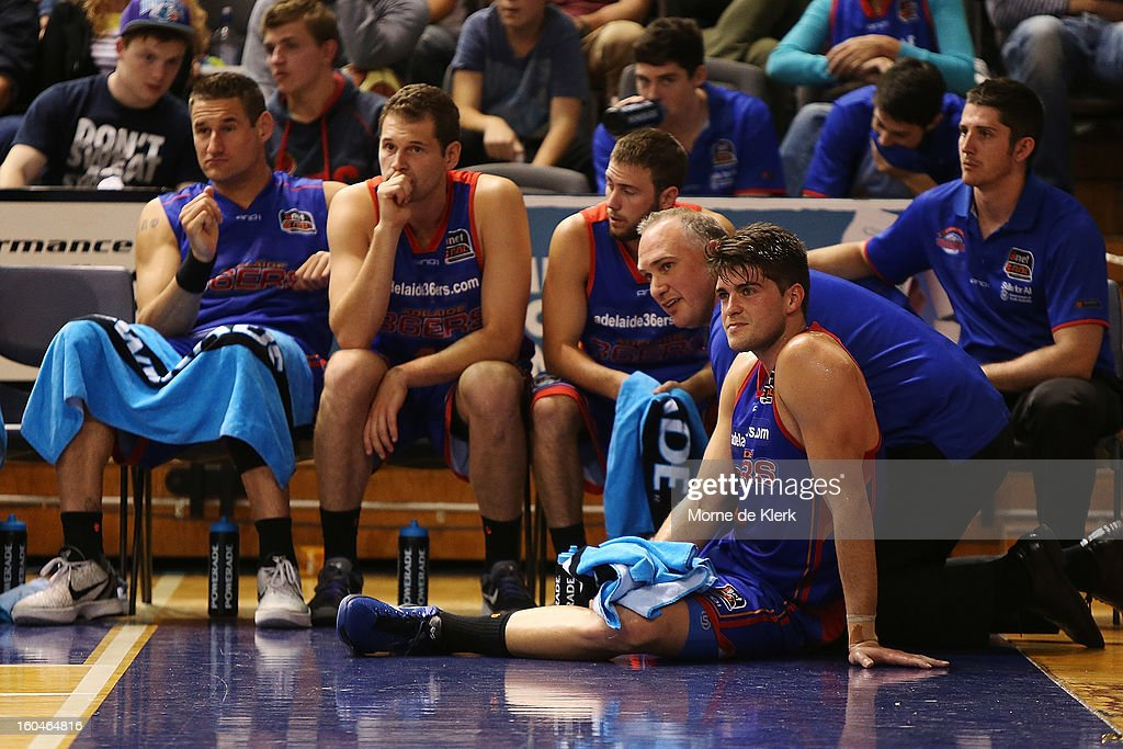 Stephen Weigh (2R) of Adelaide receives treatment after a possible injury during the round 17 NBL match between the Adelaide 36ers and the Wollongong Hawks at Adelaide Arena on February 1, 2013 in Adelaide, Australia.