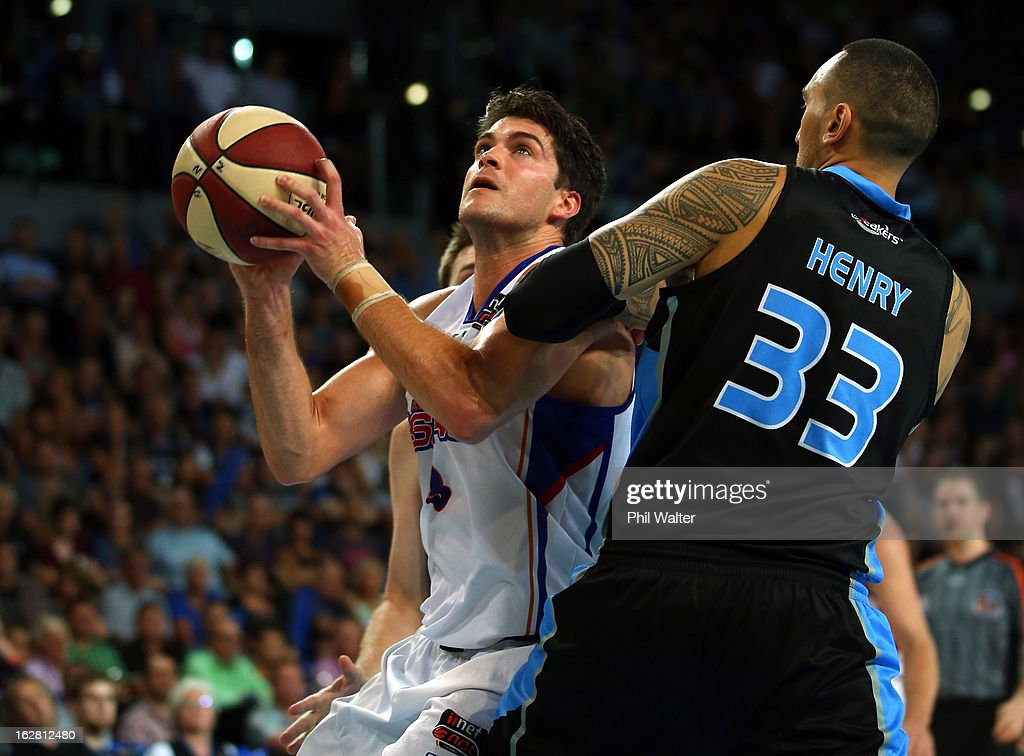 Stephen Weigh of the 36ers lays up the ball under pressure from Leon Henry of the Breakers during the round 21 NBL match between the New Zealand Breakers and the Adelaide 36ers at Vector Arena on February 28, 2013 in Auckland, New Zealand.