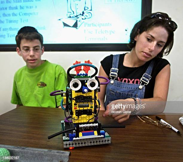 Stephen Weinberger of New Rochelle NY and Arielle Eisenbaum of Newton Mass examine a robot in a class on artificial intelligence and life at Brandeis...
