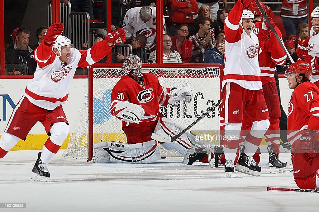 Stephen Weiss #90 of the Detroit Red Wings celebrates his game-winning goal in overtime during an NHL game against the Carolina Hurricanes on October 4, 2013 in the home opener at PNC Arena in Raleigh, North Carolina.