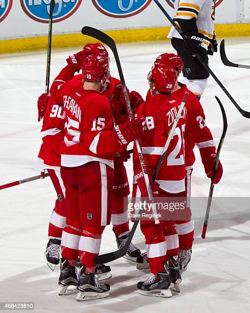 Stephen Weiss of the Detroit Red Wings celebrates with teammates Riley Sheahan Marek Zidlicky Tomas Tatar and Darren Helm after scoring a goal...