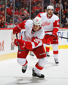 Stephen Weiss of the Detroit Red Wings chases down a loose puck against the Calgary Flames at Scotiabank Saddledome on January 2 2015 in Calgary...