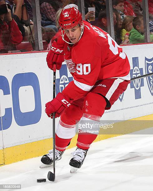 Stephen Weiss of the Detroit Red Wings controls the puck against the San Jose Sharks during an NHL game at Joe Louis Arena on October 21 2013 in...