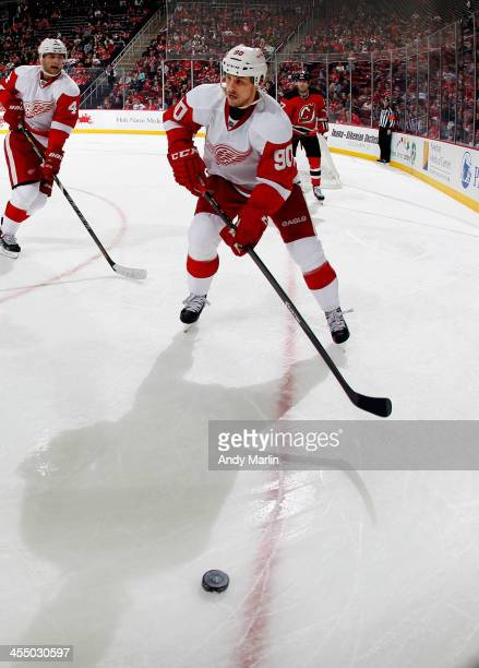Stephen Weiss of the Detroit Red Wings plays the puck against the New Jersey Devils during the game at the Prudential Center on December 6 2013 in...