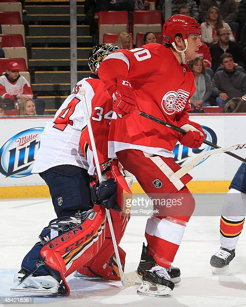 Stephen Weiss of the Detroit Red Wings screens goalie Tim Thomas of the Florida Panthers during an NHL game at Joe Louis Arena on December 7 2013 in...