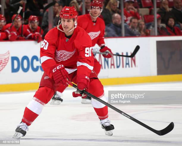 Stephen Weiss of the Detroit Red Wings skates up ice during an NHL game against the Ottawa Senators at Joe Louis Arena on November 23 2013 in Detroit...