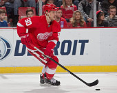 Stephen Weiss of the Detroit Red Wings skates up ice with the puck during a NHL game against the Ottawa Senators on March 31 2015 at Joe Louis Arena...