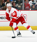 Stephen Weiss of the Detroit Red Wings skates up ice with the puck during their NHL game against the Vancouver Canucks at Rogers Arena January 3 2015...