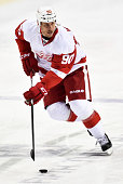 Stephen Weiss of the Detroit Red Wings skates with the puck against the Nashville Predators during a NHL game at Bridgestone Arena on February 28...