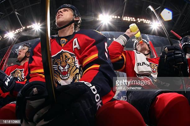 Stephen Weiss of the Florida Panthers and teammate Tomas Kopecky sit on the bench between shifts against the Tampa Bay Lightning at the BBT Center on...