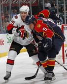 Stephen Weiss of the Florida Panthers and Zack Smith of the Ottawa Senators skate after a loose puck on March 10 2011 at the BankAtlantic Center in...