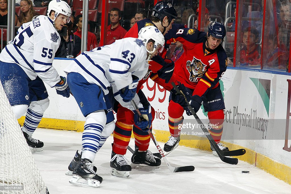 Stephen Weiss #9 of the Florida Panthers digs the puck out from the boards against Nazem Kadri #43 and Korbinian Holzer #55 of the Toronto Maple Leafs at the BB&T Center on February 18, 2013 in Sunrise, Florida.