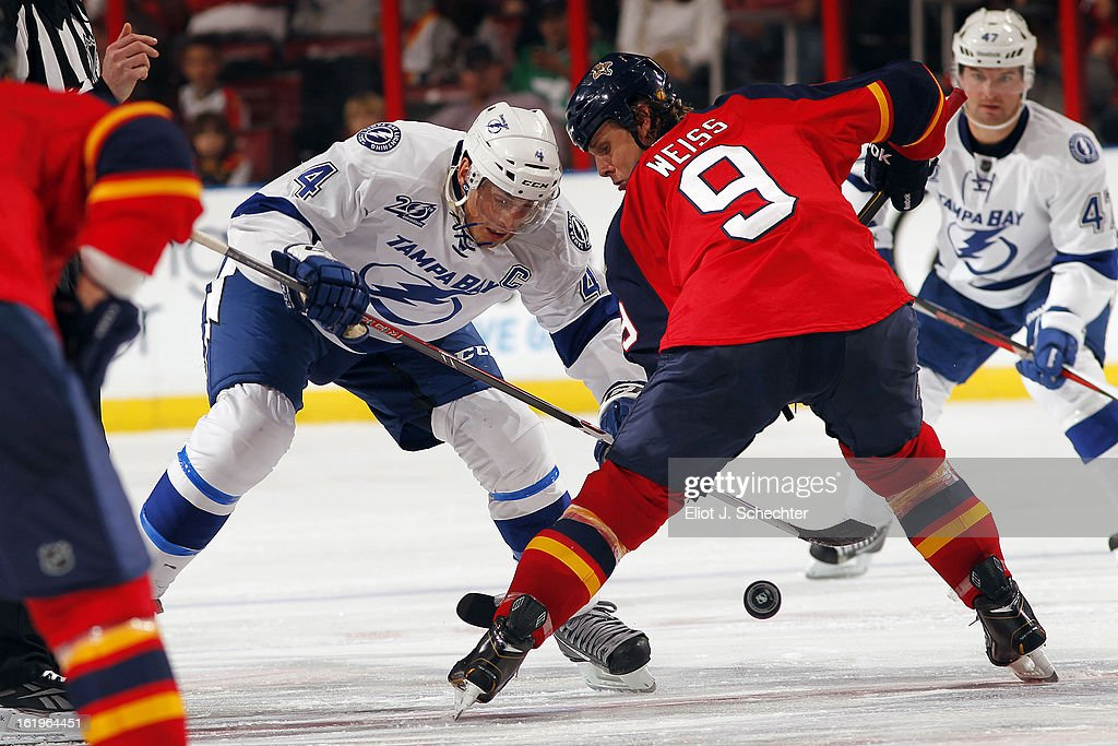 Stephen Weiss #9 of the Florida Panthers faces off against Vincent Lecavalier #4 of the Tampa Bay Lightning at the BB&T Center on February 16, 2013 in Sunrise, Florida.