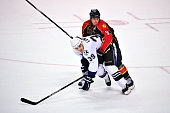 Stephen Weiss of the Florida Panthers grabs Mike Lundin of the Tampa Bay Lightning during a NHL game on March 12 2011 at the BankAtlantic Center in...