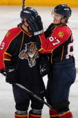 Stephen Weiss of the Florida Panthers has his face covered up by teammate Michael Frolik after scoring a goal against the Nashville Predators at the...