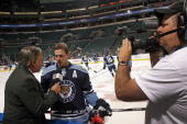 Stephen Weiss of the Florida Panthers is interviewed by Frank Forte of Fox Sports Network prior to the start of the game against Tampa Bay Lightning...
