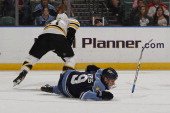 Stephen Weiss of the Florida Panthers loses his stick as he is tripped by Andrew Ference of the Boston Bruins on November 24 2010 at the BankAtlantic...