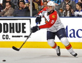 Stephen Weiss of the Florida Panthers passes the puck during game action against the Toronto Maple Leafs October 26 2010 at the Air Canada Centre in...