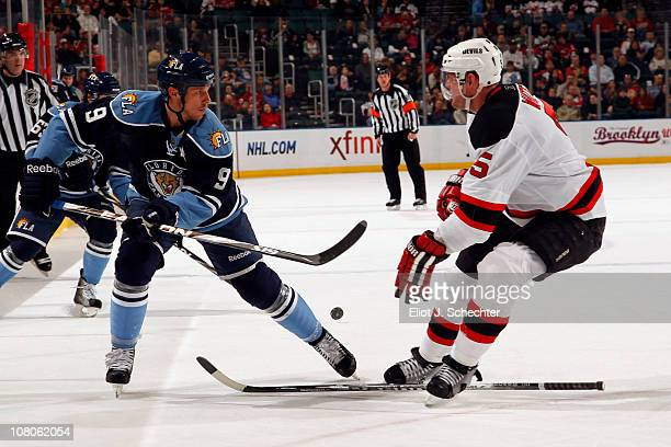 Stephen Weiss of the Florida Panthers skates against a stick less Colin White of the New Jersey Devils at the BankAtlantic Center on January 15 2011...