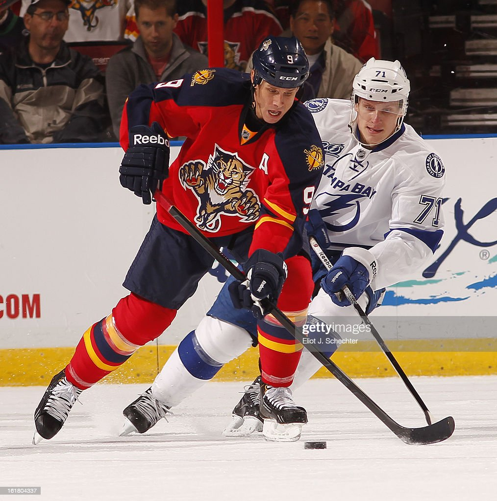 Stephen Weiss #9 of the Florida Panthers skates with the puck against Richard Panik #71 of the Tampa Bay Lightning at the BB&T Center on February 16, 2013 in Sunrise, Florida.