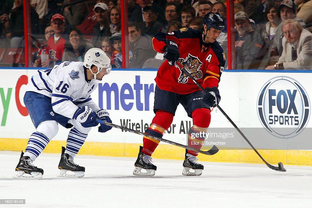 Stephen Weiss #9 of the Florida Panthers skates with the puck against Clarke MacArthur #16 of the Toronto Maple Leafs at the BB&T Center on February 18, 2013 in Sunrise, Florida.