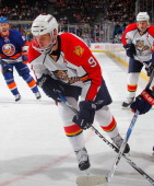 Stephen Weiss of the Florida Panthers skates with the puck during a hockey game against the New York Islanders at the Nassau Coliseum on November 20...