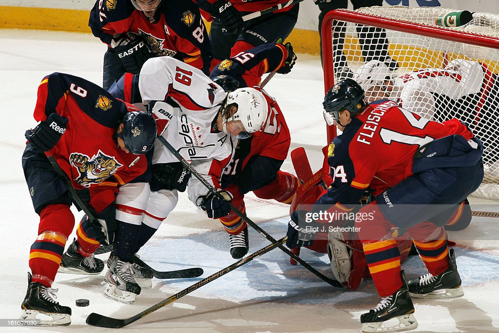 Stephen Weiss #9 of the Florida Panthers tangles with Nicklas Backstrom #19 of the Washington Capitals at the BB&T Center on February 12, 2013 in Sunrise, Florida.