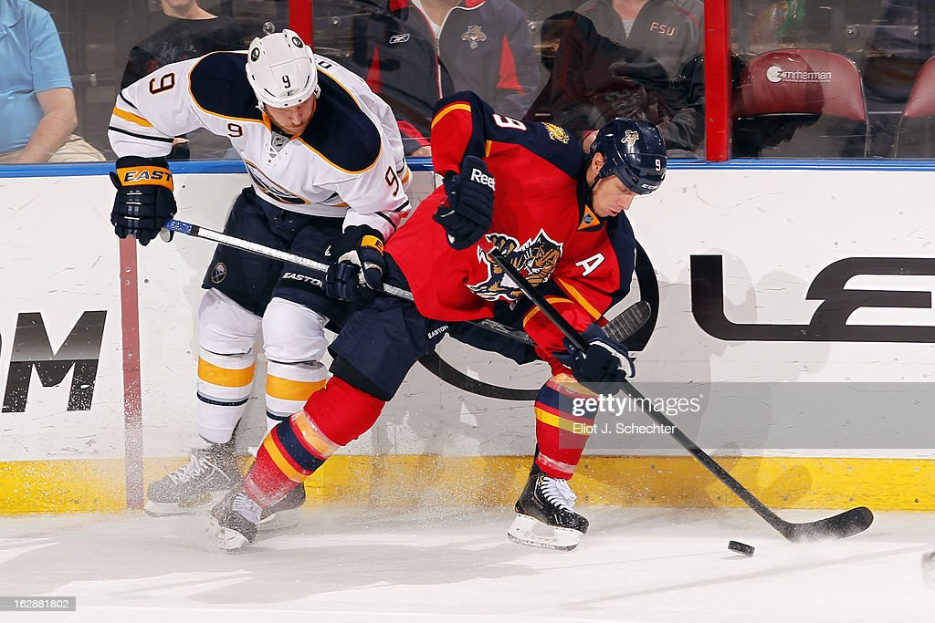 Stephen Weiss #9 of the Florida Panthers tangles with <a gi-track='captionPersonalityLinkClicked' href=/galleries/search?phrase=Steve+Ott&family=editorial&specificpeople=210616 ng-click='$event.stopPropagation()'>Steve Ott</a> #9 of the Buffalo Sabres during overtime at the BB&T Center on February 28, 2013 in Sunrise, Florida.